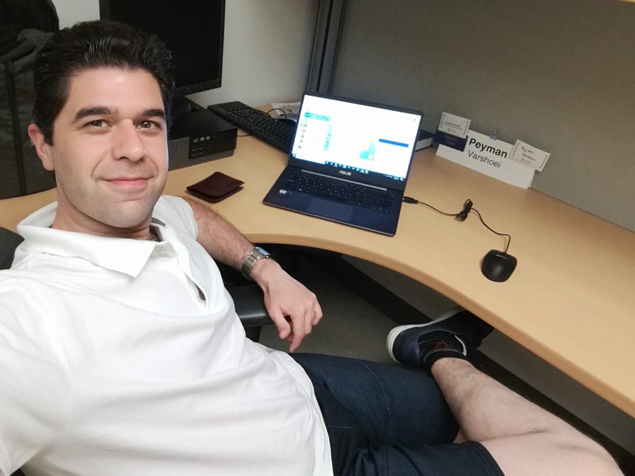 phd-student-peyman-varshoei-working-on-computer-casually-dressed