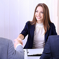 Woman shaking hand with interviewer