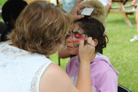 Child having her face painted