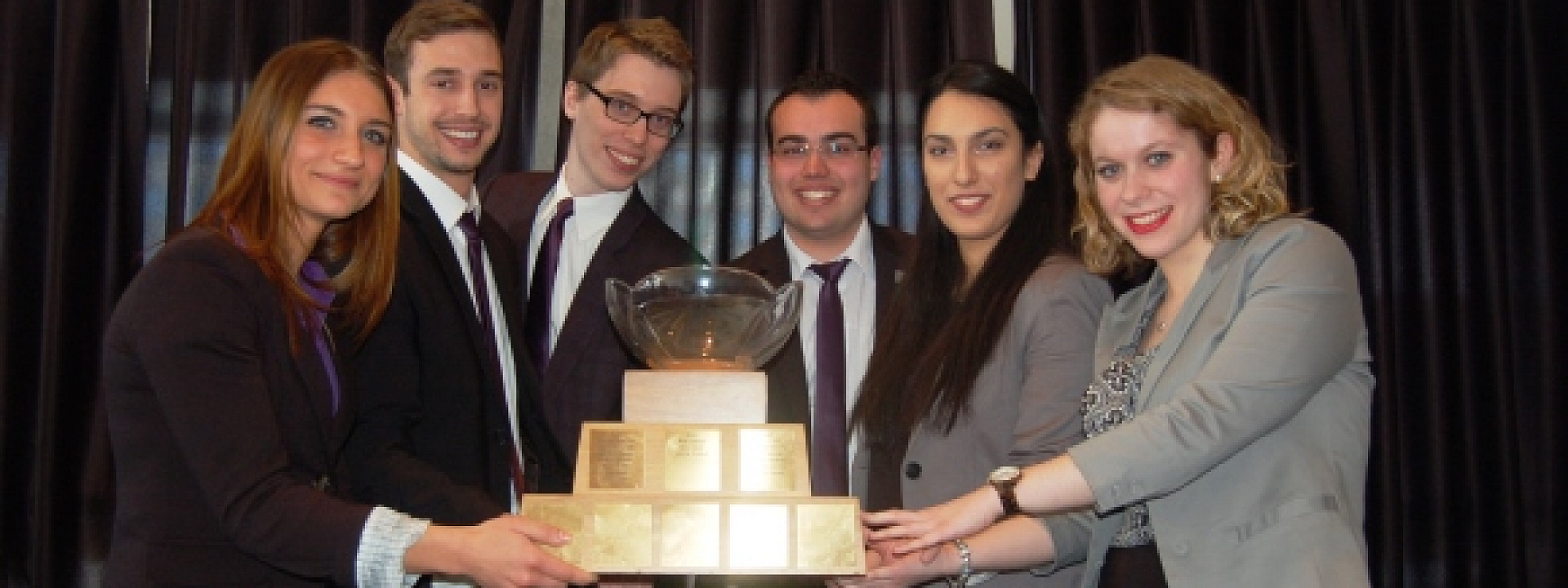 winning team holding the Michel Cloutier Trophee