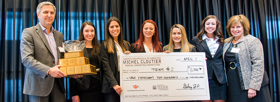 Michel Cloutier Winners Holding a Big Cheque