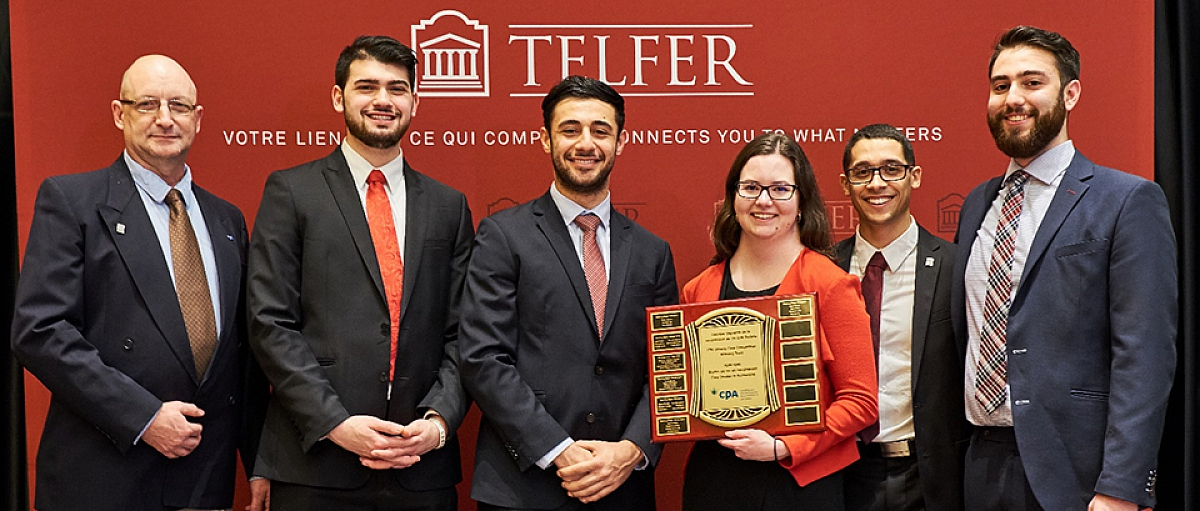 Winners of the CPA Accounting Case Competition holding their plaque