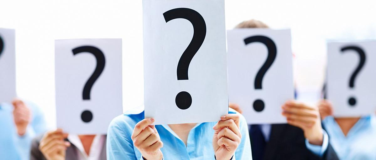 Photo of women holding question mark