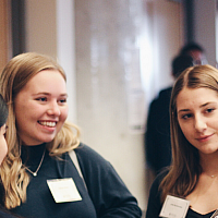 Students speaking at a networking event