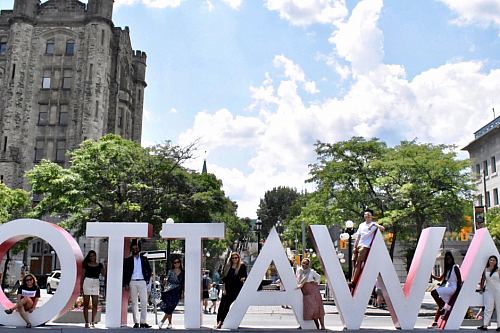 students in front of OTTAWA giant letters