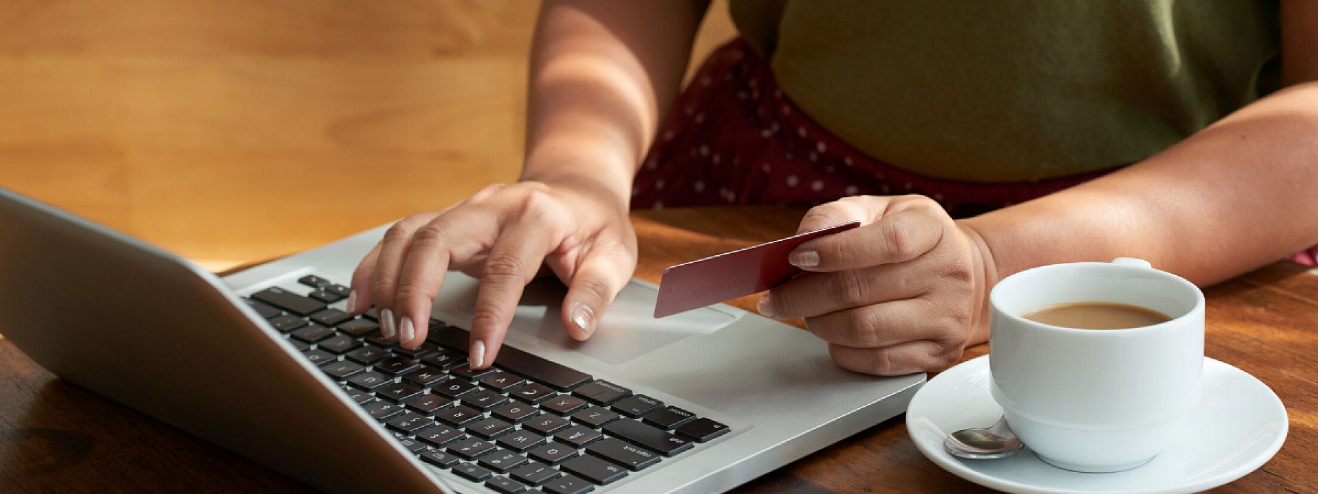 person shopping online holding credit card