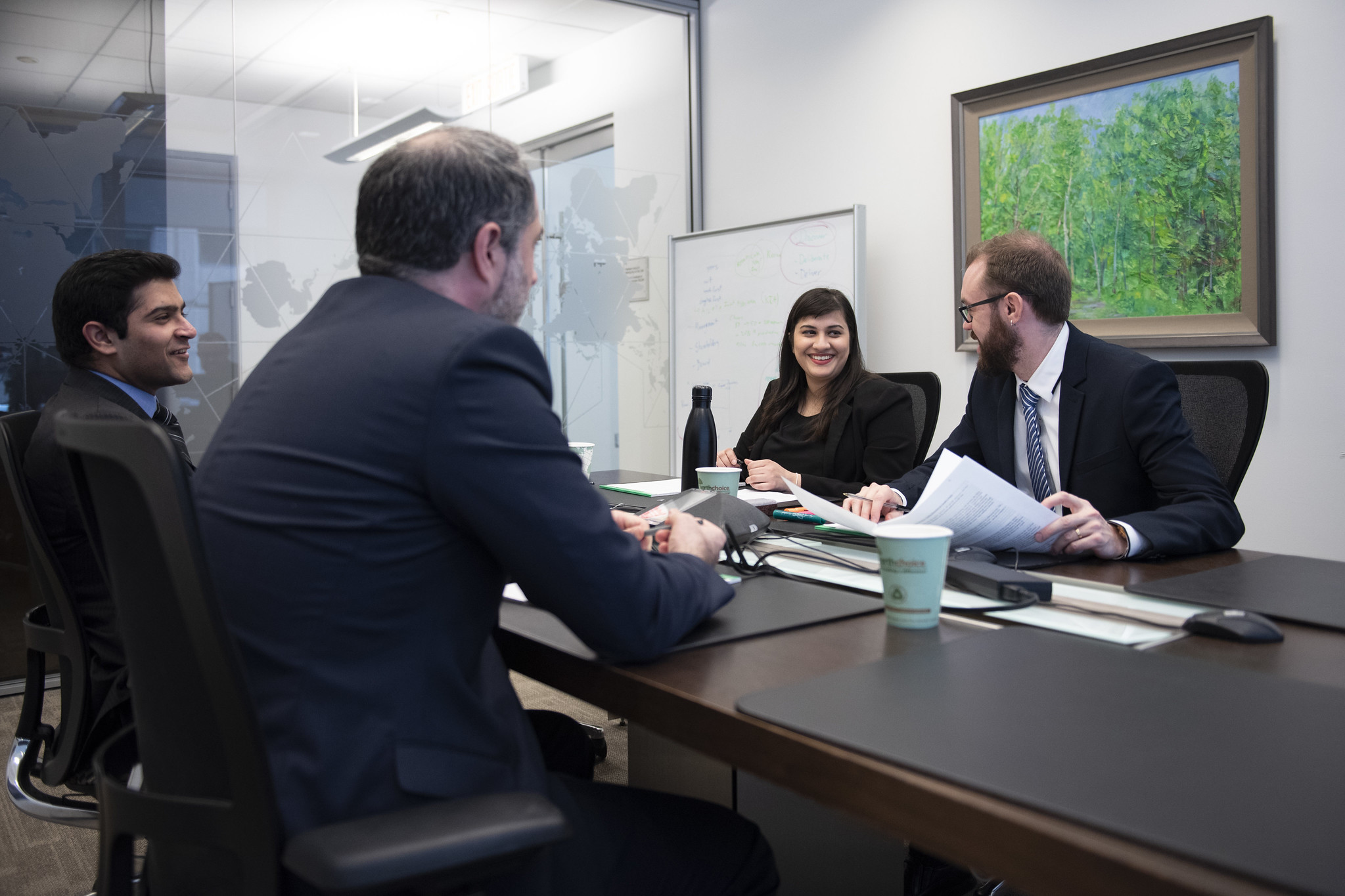 business people discussing around a conference table