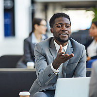 black business man talking smiling in workplace