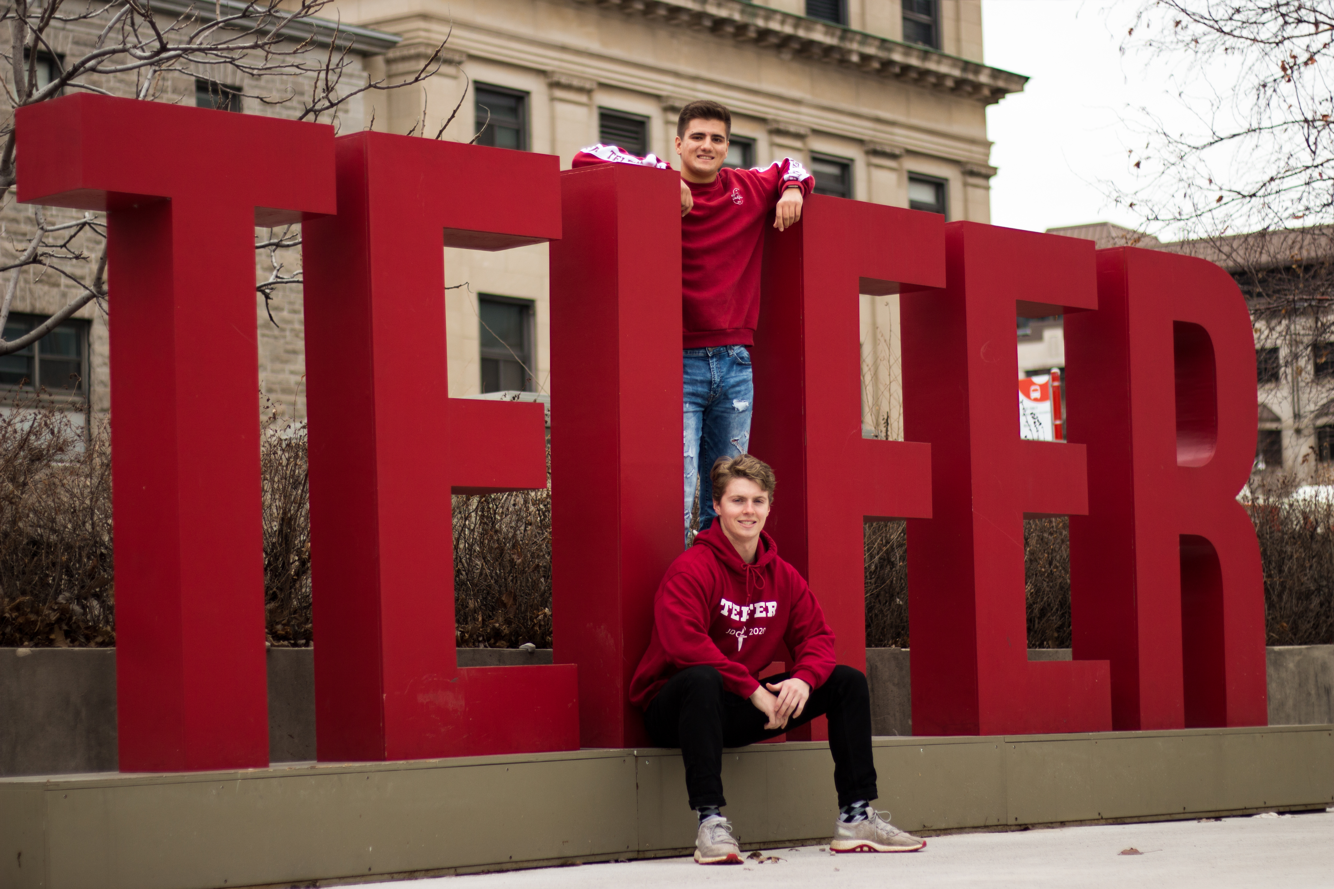 Telfer students in front of the Telfer sign on campus