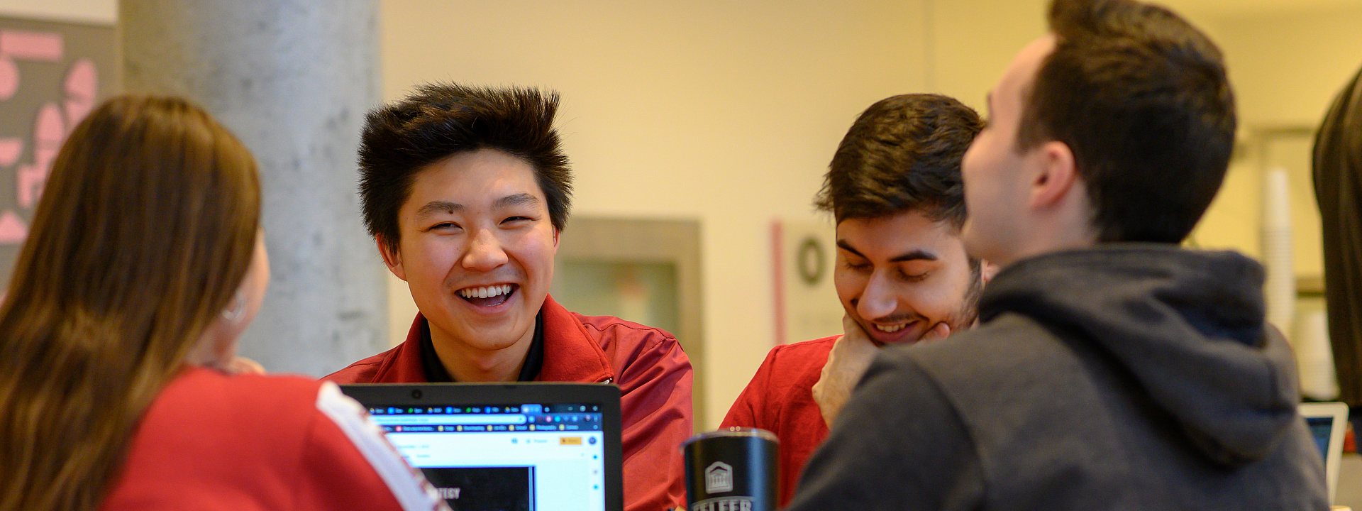 Group of Telfer students studying and laughing together