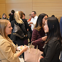 Student talking at a networking event