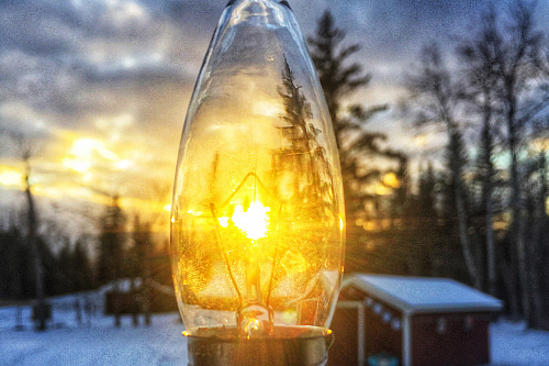 Light bulb with sun on backgound