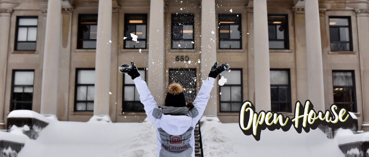 Student throwing snow in the air at open house
