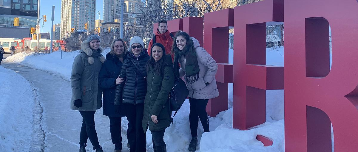 students smiling in front of big TELFER letters