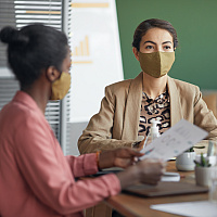 Business women wearing mask